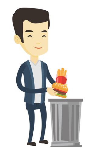 Man throwing junk food in the trash