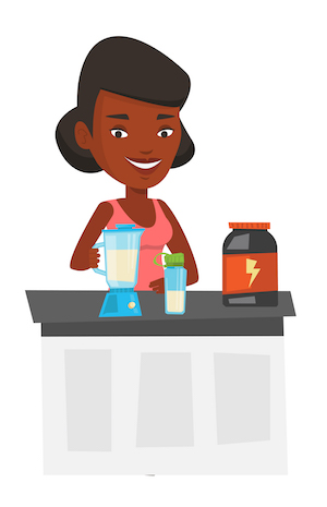Woman making protein shake using blender.