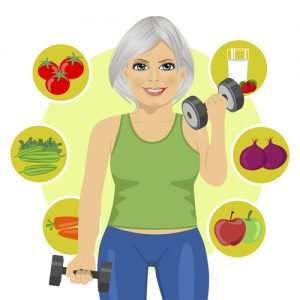 sporty senior woman with dumbbells and variety of healthy vegetables